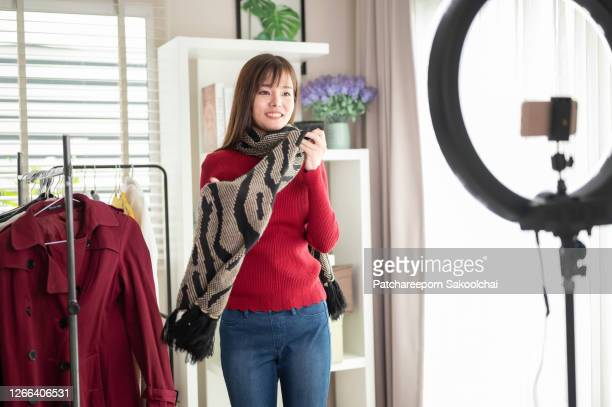 asian woman, blogger review product on live streaming, work at home - unboxing stock pictures, royalty-free photos & images