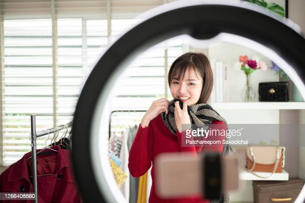 asian woman, blogger review product on live streaming, work at home - live broadcast stock pictures, royalty-free photos & images
