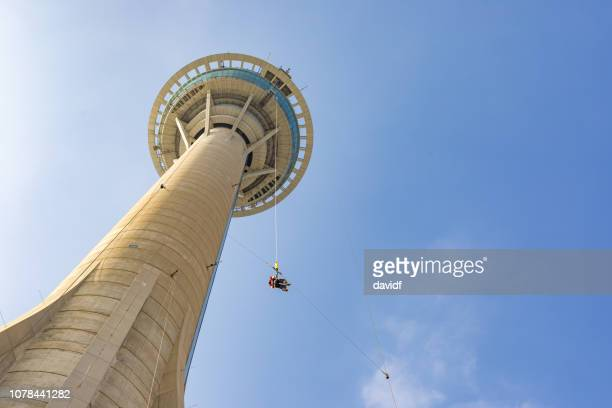Asian Woman Bungy Jumping from Macau Skytower