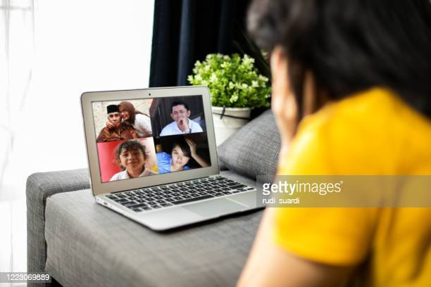 asian woman conference call with family - indonesia stock pictures, royalty-free photos & images