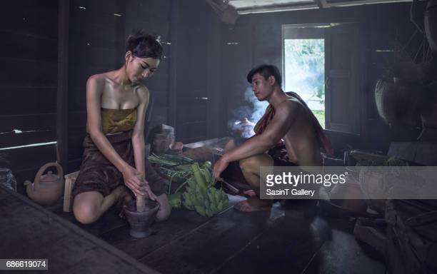 asian woman cooking at home - pretty vietnamese women stock photos and pictures