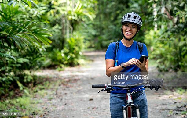 Asian woman cycling outdoors with GPS