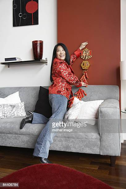 Asian Woman decorating for Chinese New Year