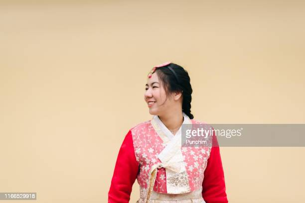 asian woman dressed hanbok pose of standing in seoul, south korea - korean culture stock pictures, royalty-free photos & images