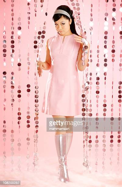 asian woman dressed in retro clothing - silver dress stock pictures, royalty-free photos & images