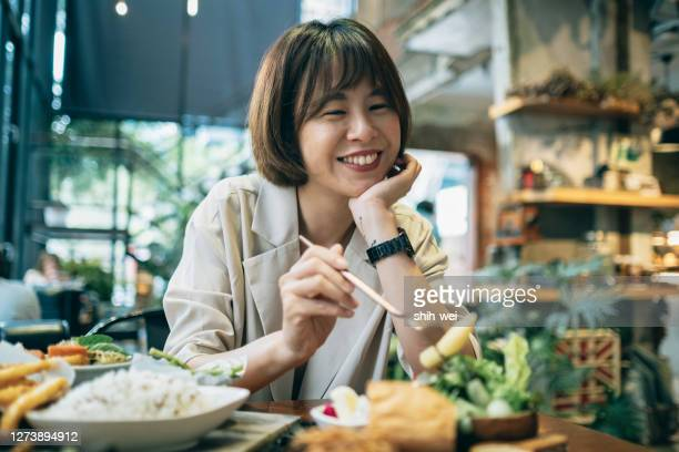 asian woman eating breakfast - korean ethnicity stock pictures, royalty-free photos & images