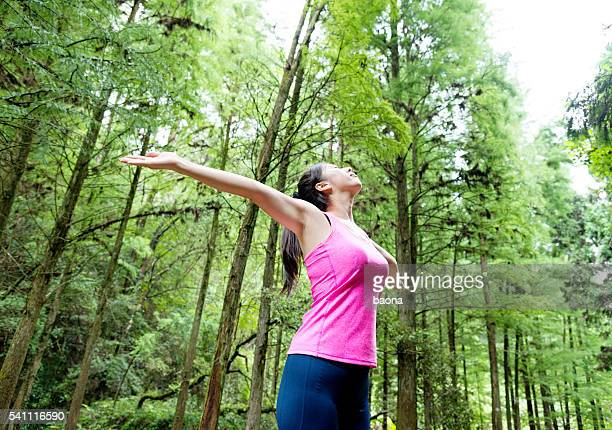 Asian woman enjoying fresh air