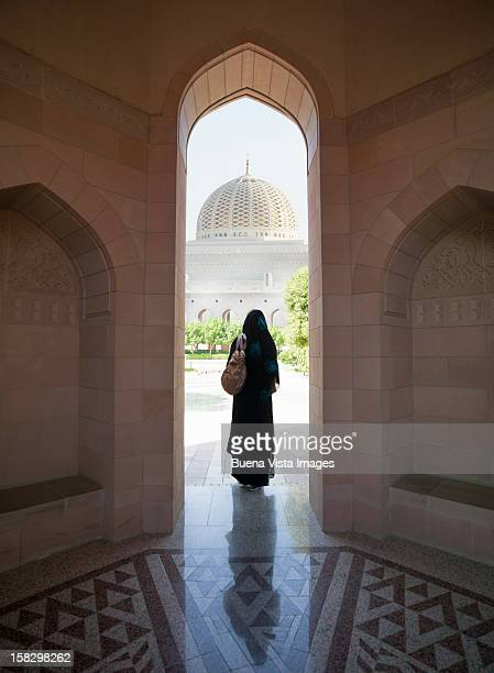 Oriental woman entering a Mosque