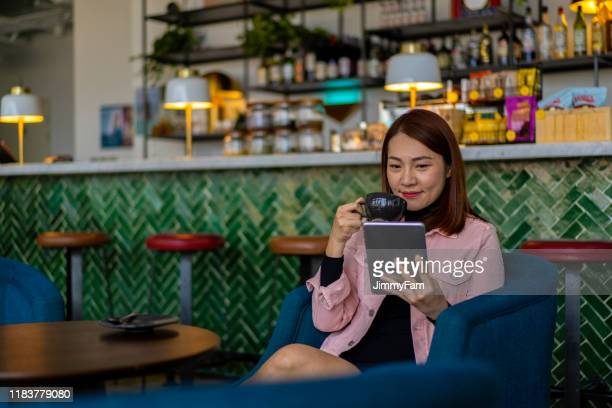 asian woman executive working at café. - publication stock pictures, royalty-free photos & images