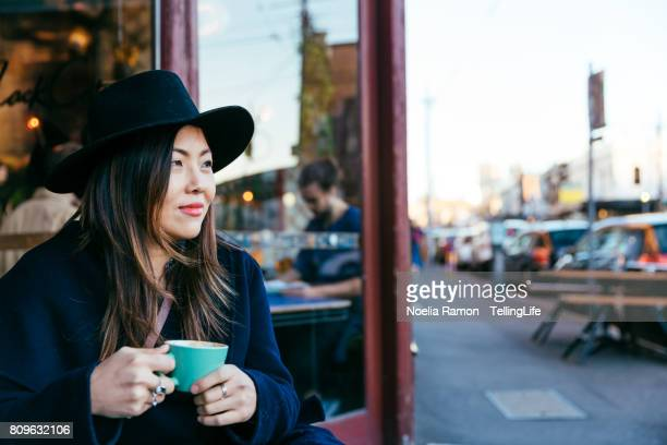 asian woman - fashion street style fitzroy, melbourne - melbourne australia stock pictures, royalty-free photos & images