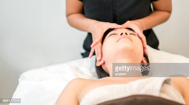 Asian woman getting a face massage at the spa