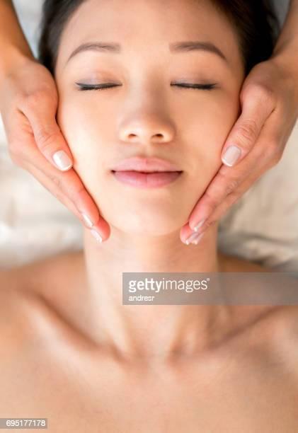 Asian woman getting a facial at the spa