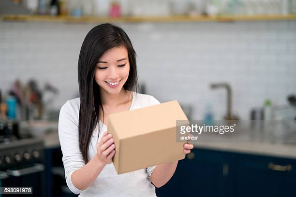 asian woman getting the mail at home - openmaken stockfoto's en -beelden