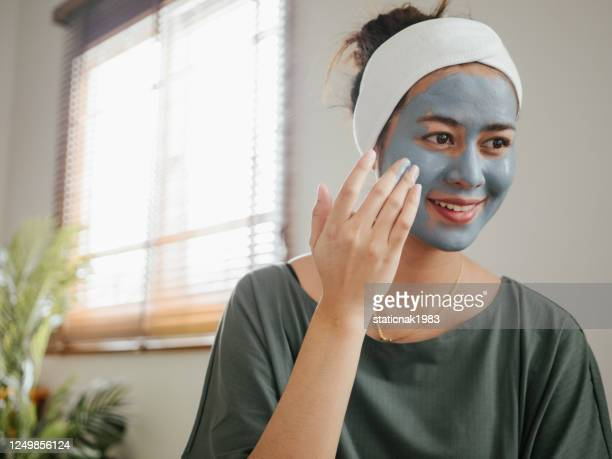 asian woman having beauty treatment at home - natural condition stock pictures, royalty-free photos & images