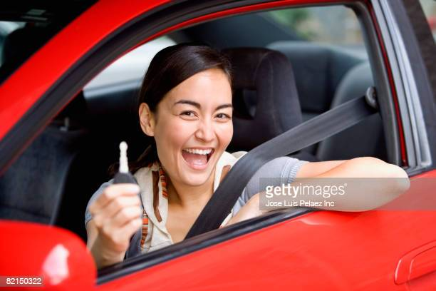 asian woman holding  car key in car - new stock pictures, royalty-free photos & images