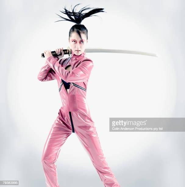 Asian woman holding samurai sword