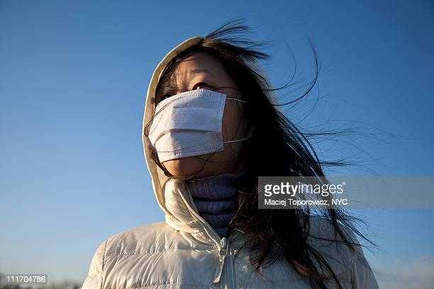 Asian woman in a cotton face mask.
