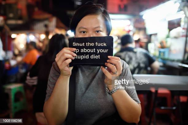 asian woman in a thai street food market not dieting - one night stand stock-fotos und bilder