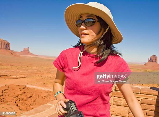 Asian woman in desert