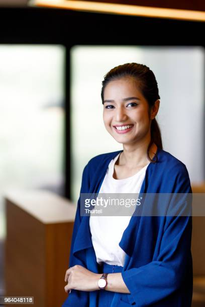 asian woman in modern office - malaysian culture stock pictures, royalty-free photos & images