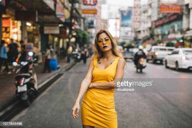 asian woman in the city - yellow dress stock pictures, royalty-free photos & images