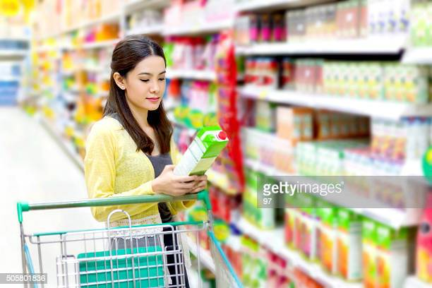 Asian woman in the supermarket to buy of juice
