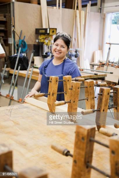 Asian woman in workshop