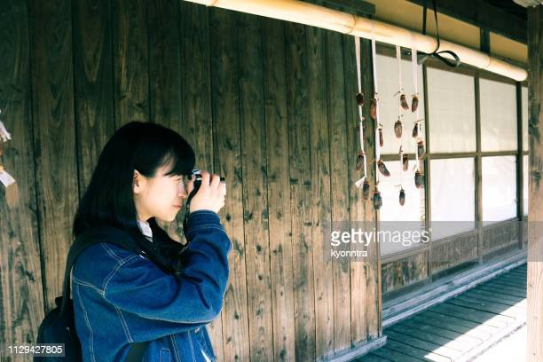 Asian woman is taking a photo