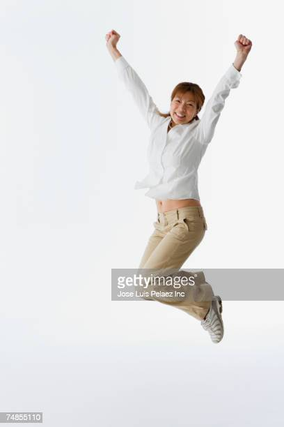 Asian woman jumping