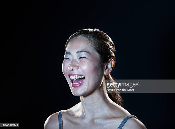 asian woman laughing. - east asian ethnicity stock pictures, royalty-free photos & images