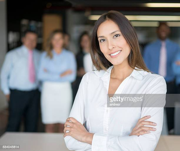 Asian woman leading a business group