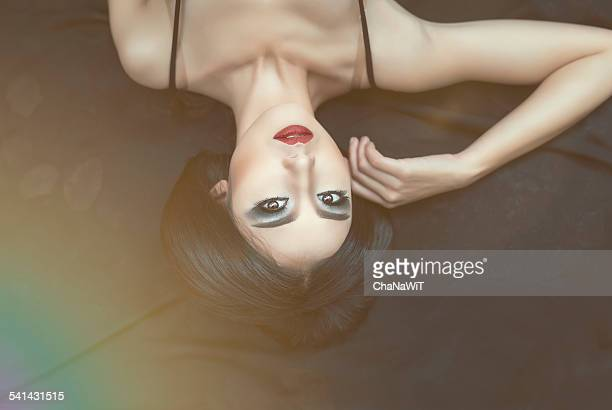 Asian woman lie down on the rock