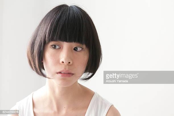 Asian woman looking away