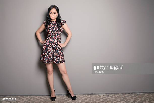 asian woman looking - women wearing short skirts stock pictures, royalty-free photos & images