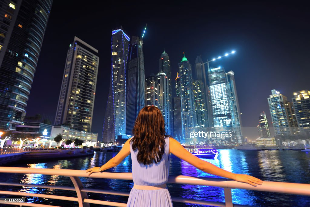 Asian Woman Looking The Cityscape Of Dubai Stock Photo | Getty Images