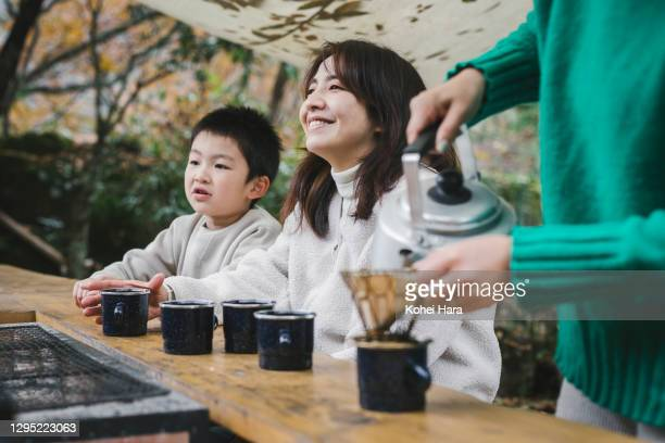 asian woman making coffee outdoors - offbeat stock pictures, royalty-free photos & images