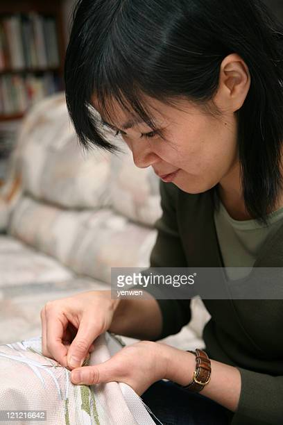 Asian Woman Making Cross-Stitch