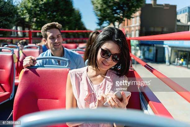 Asian woman on a tour bus