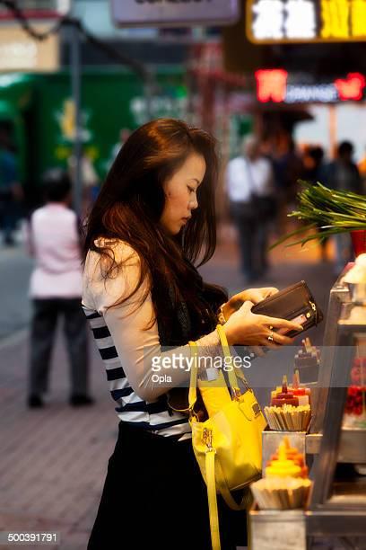 Asian woman ordering Hong Kong street food