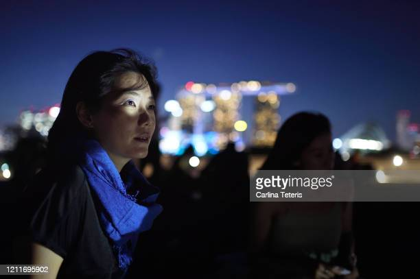 asian woman outdoors in the city at night - singapore stock pictures, royalty-free photos & images
