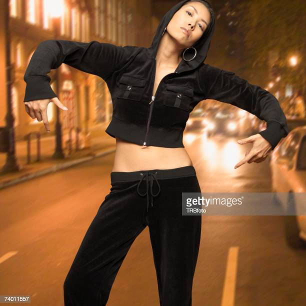 Asian woman posing in street