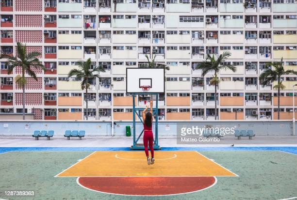 asian woman pretending to play basketball, hong kong - local landmark stock pictures, royalty-free photos & images