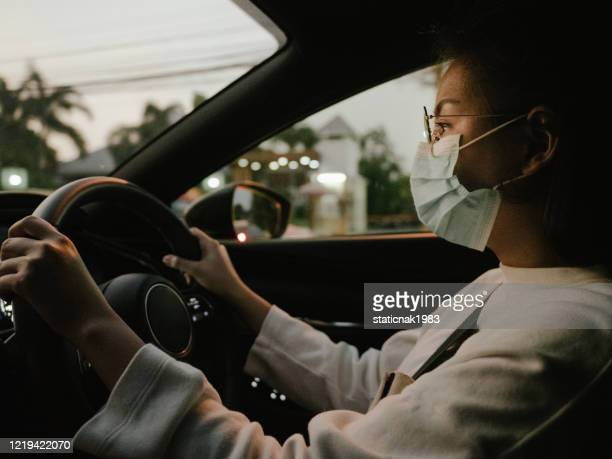 asian woman protect yourself from the covid-19 with masks - driving mask stock pictures, royalty-free photos & images