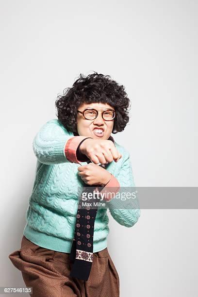 Asian woman punching air