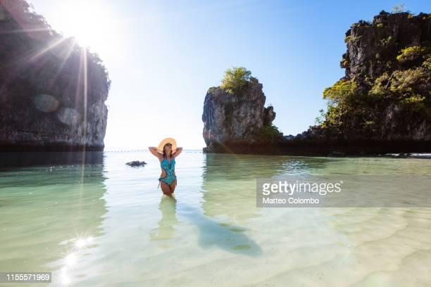 asian woman relaxing at hong island, thailand - railay strand stock-fotos und bilder