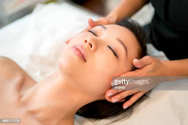 Asian woman relaxing at the spa
