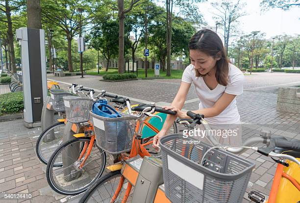 Asian woman renting a bike in Hong Kong