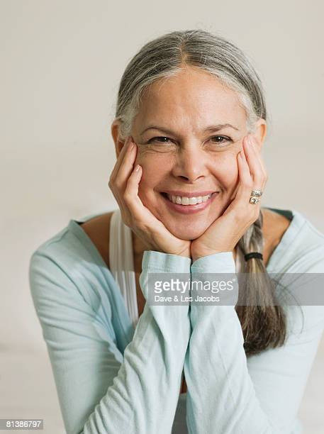 Asian woman resting chin in hands