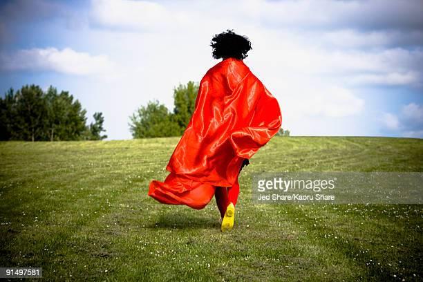 Asian woman running in field