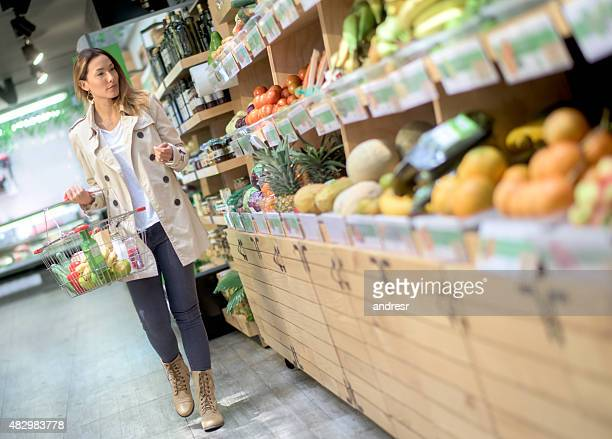 Asian woman shopping at the grocery shop